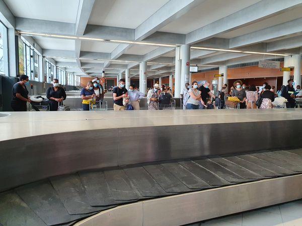 Attente bagages Arrivée aéroport Martinique
