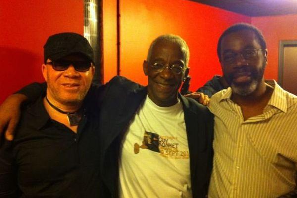 Le chanteur James Germain , michel Reinette organisateur de la manifestation, et le batteur de Kassav Claude Vamur