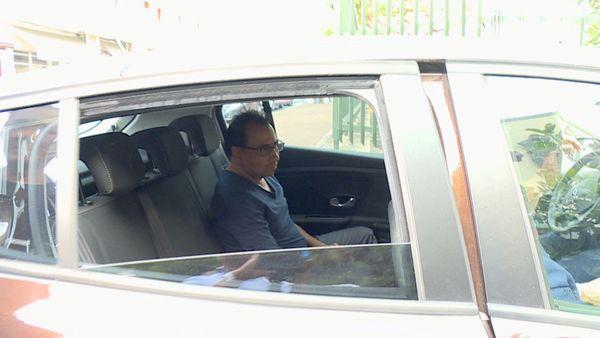 Ibrahim Patel dans voiture police