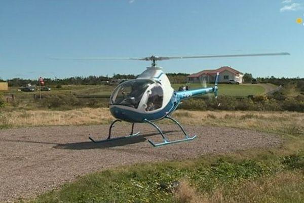 Marcel Hélène aux commandes d'un hélicoptère privé