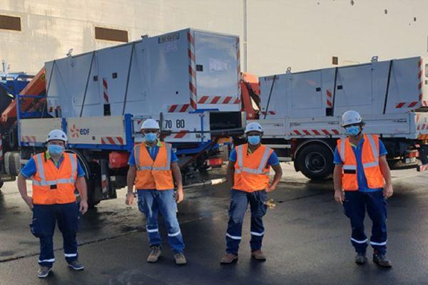 Les techniciens EDF ayant organisés le transfert du matériel