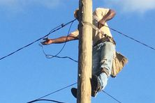 ouvrier de la société d'électricité de Cuba
