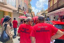 """Des participants au défilé du Collectif des Ouvriers Agricoles de Martinique du 27 mars 2021, pour réclamer """"justice"""" et """"réparation"""" à l'Etat."""