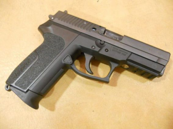© Un Sig Sauer SP2022. (Photo illustration Drouillet Dreumont)